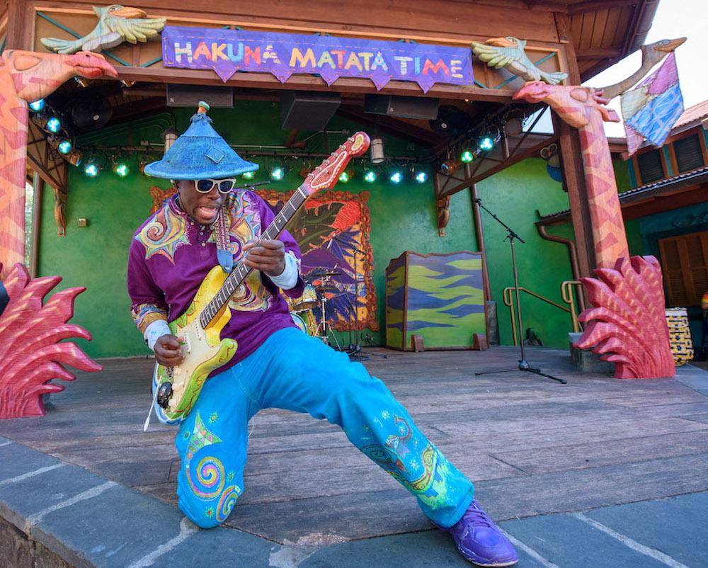 Man playing guitar at Hakuna Matata Dance party