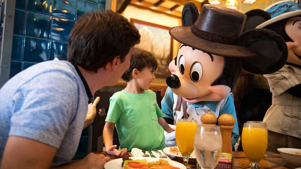 Mickey Mouse meets a little boy at breakfast