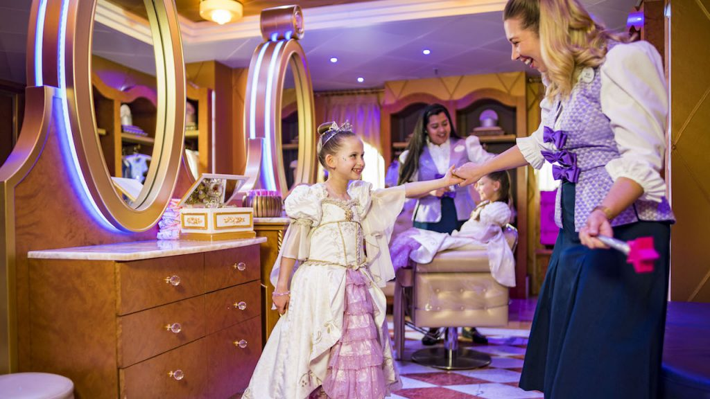 little girl dressed in a beautiful gown and tierra, at Bibbidi Bobbidi Boutique on Disney Cruise Line ship