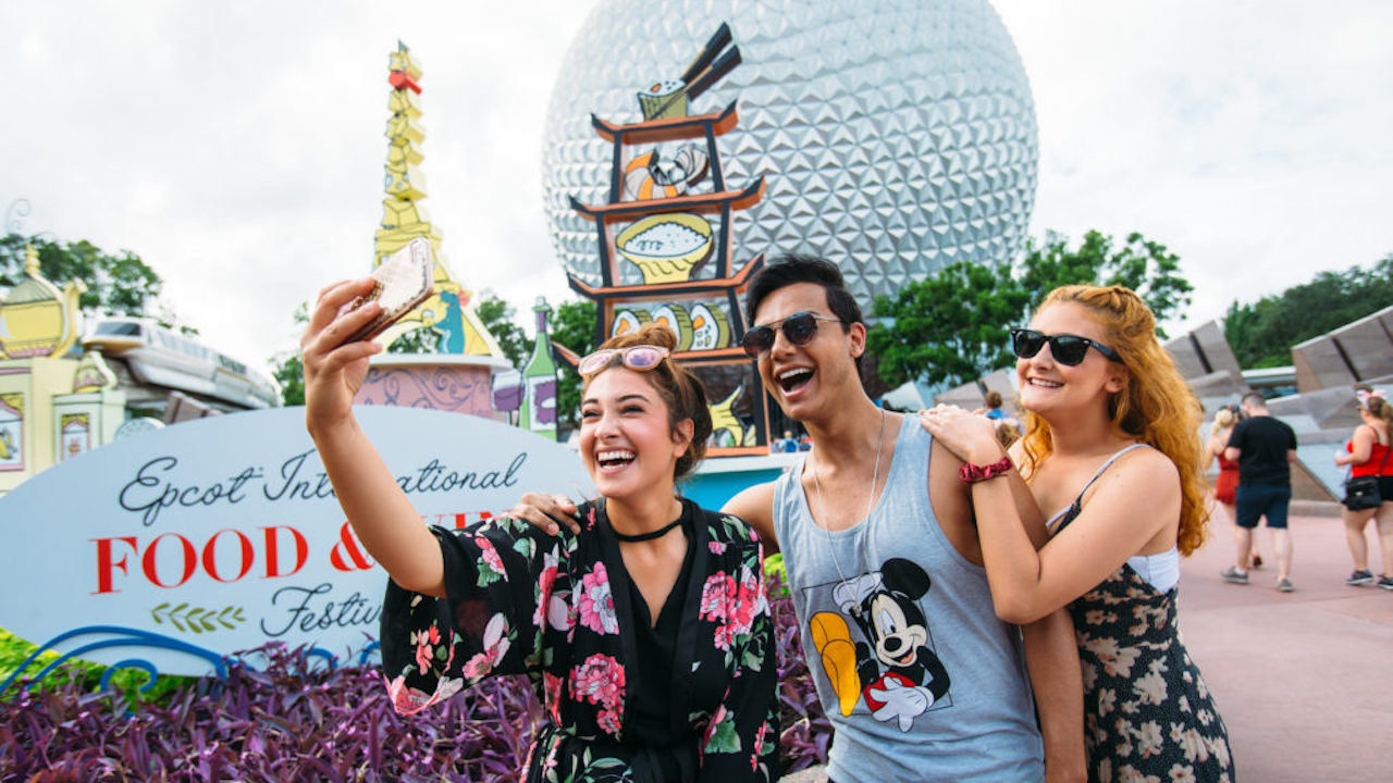 Young adults enjoying Epcot's International Food and Wine Festival