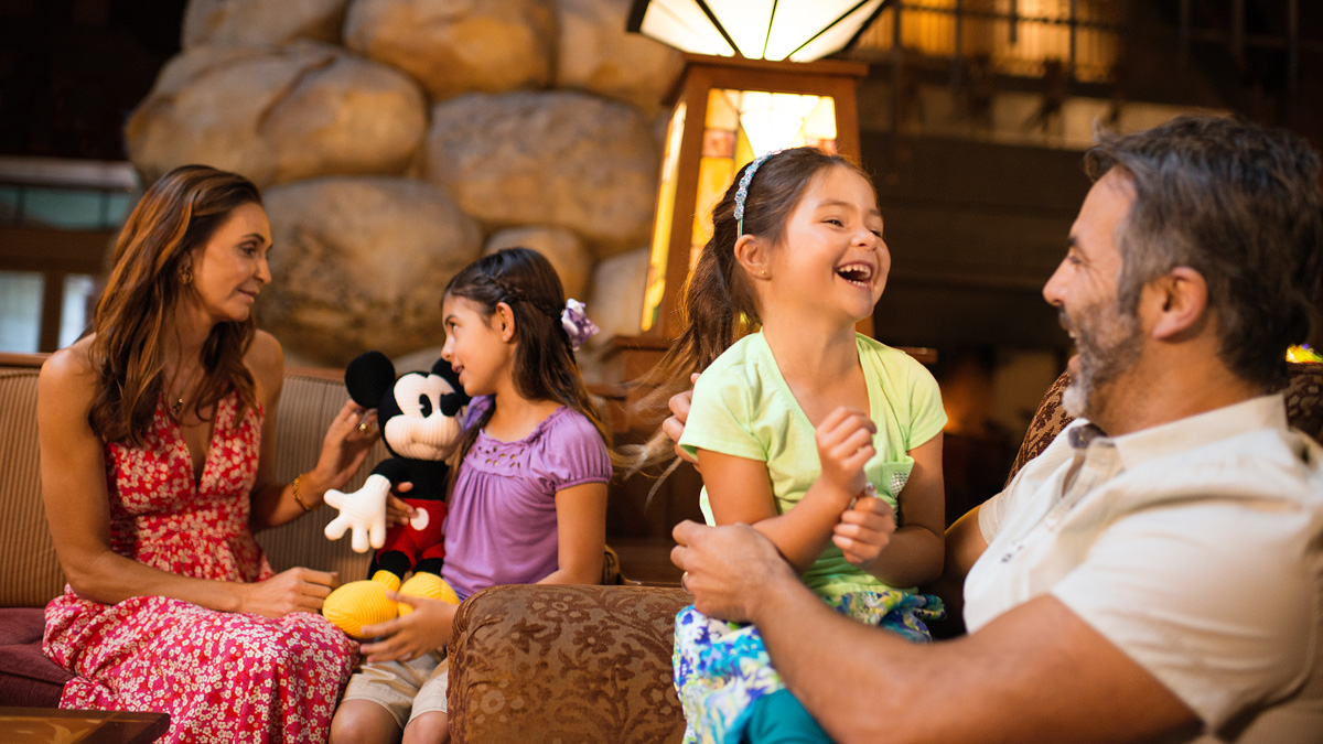 Family of 4 sitting in the lobby of Disney's Grand Californian Hotel
