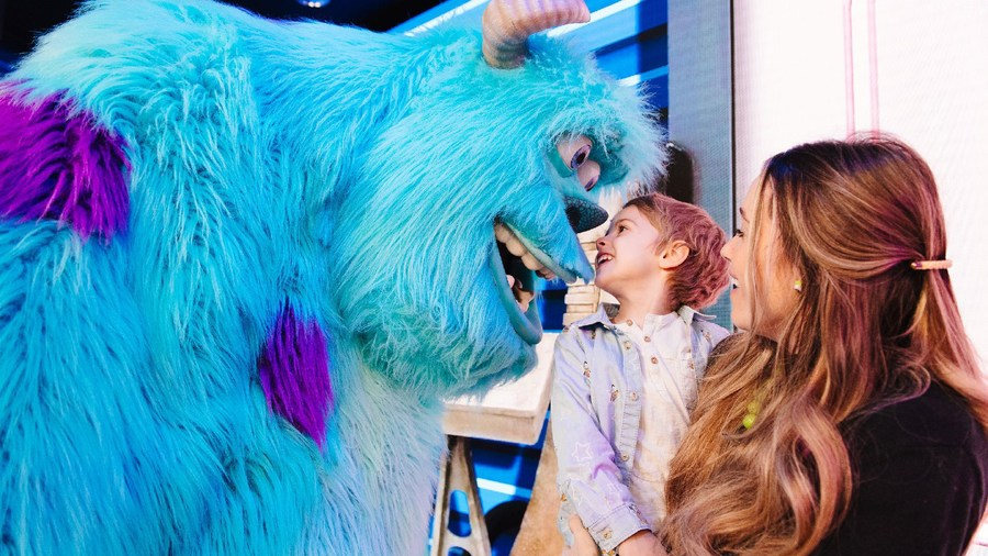 Sulley from Monsters, Inc. greets a young boy and his mother