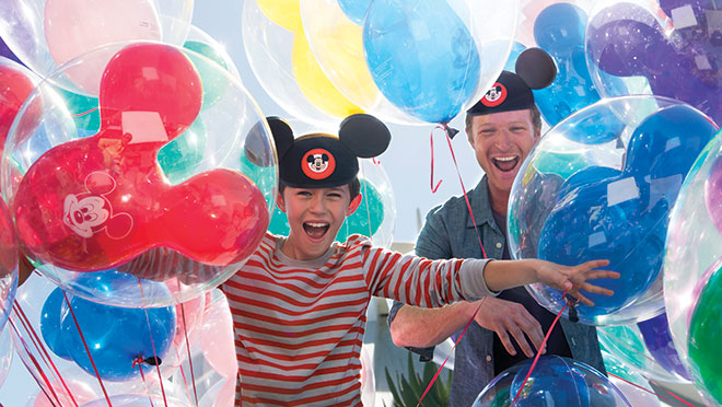 Guests with Mickey Balloons